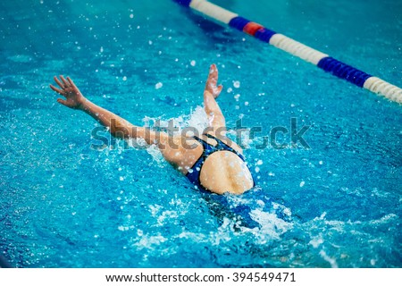 young girl athlete swimmer swims at competitions butterfly - stock photo