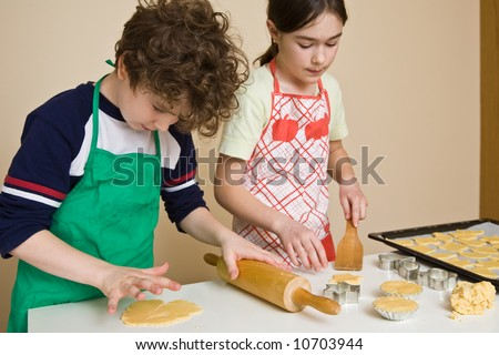 Young girl baking cakes - stock photo