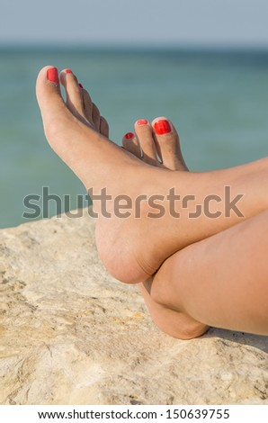 Young Girl Bare Feet Tanning On The Beach