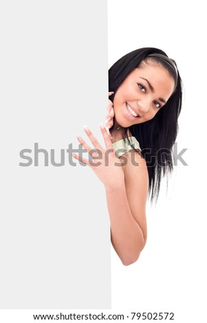 young girl behind big blank billboard, isolated on white background - stock photo