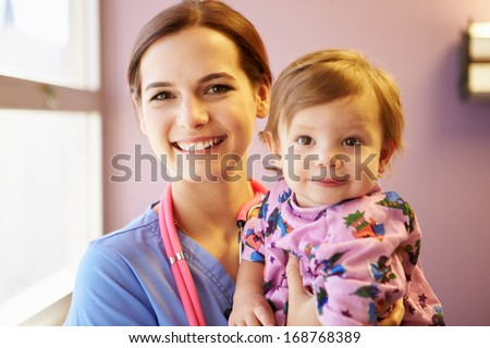 Young Girl Being Held By Female Pediatric Nurse - stock photo