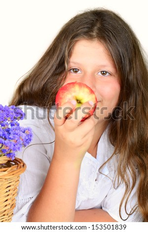 young girl biting an apple closeup portrait