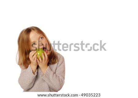 Young girl biting apple - stock photo