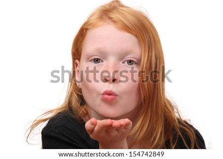 Young girl blows a kiss on white background - stock photo