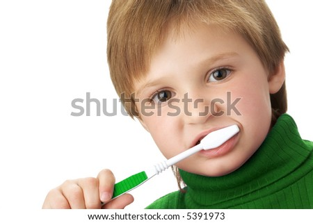 Young girl brushing her teeth; 4 years old