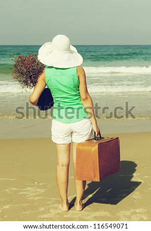 young girl came to rest at sea - stock photo