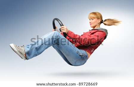 Young girl car driver in red jacket with a wheel, concept - stock photo