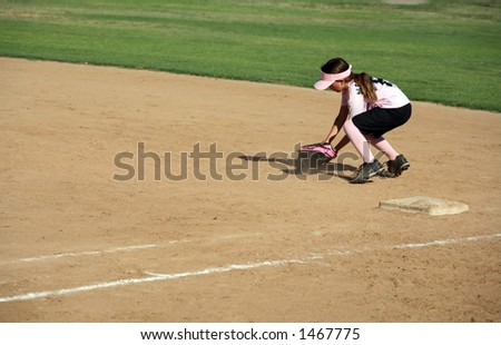 Young girl catching a ball - stock photo