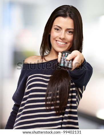young girl changing channel indoor - stock photo