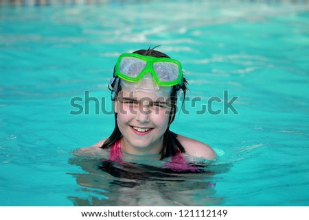Young Girl Child in a Swimming Pool - stock photo