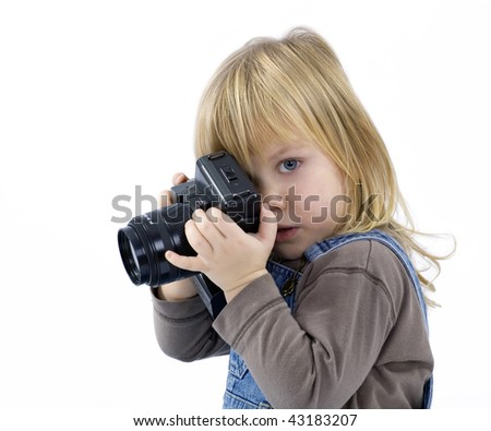 Young girl, child, trying to shoots photos on white background - stock photo