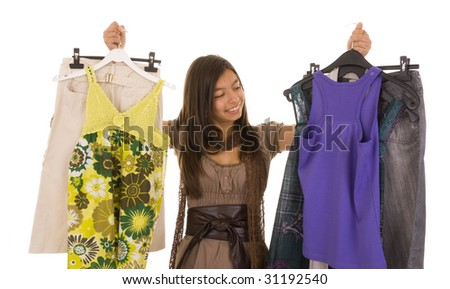 Young girl choosing new clothes isolated on white - stock photo