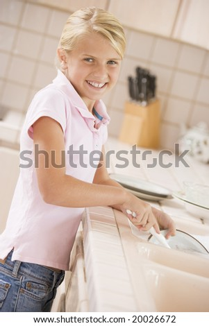 Young Girl Cleaning Dishes, - stock photo