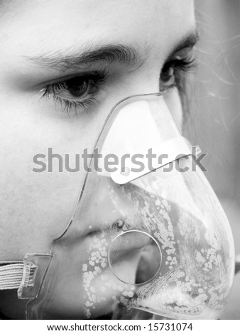 Young girl close up in oxygen mask.