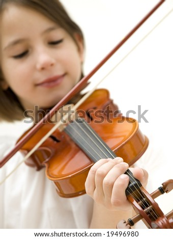 young girl closeup portrait with violin focused on hand isolated on white background - stock photo