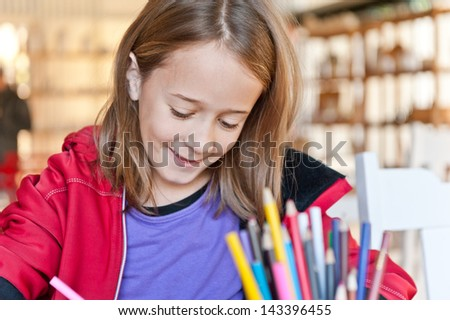 young girl colouring