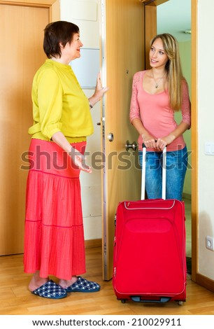 Young girl coming to mother's place with visit