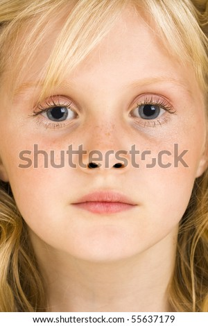 Young girl concentrates - stock photo