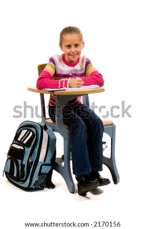 young girl concentrating on work at school desk