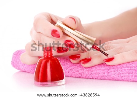 Young girl cover her nails with varnish - stock photo