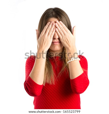 young girl covering her eyes over isolated white background  - stock photo