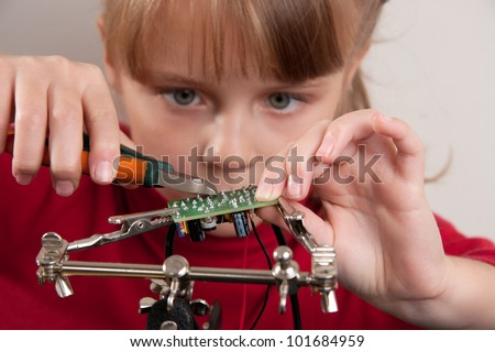 Young girl create DIY project - stock photo