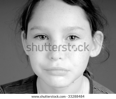 Young girl crying with tears dripping down face - stock photo