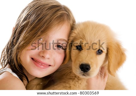 Young Girl cuddling with a cute Golden Retriever Puppy