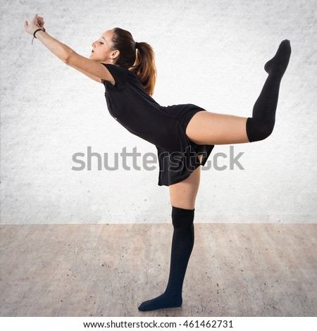 Young girl dancing over textured background