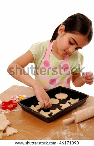 Young girl decorating biscuits