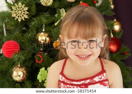 Young Girl Decorating Christmas Tree - stock photo