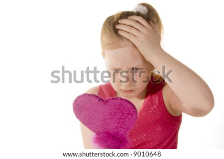 young girl discovers her first pimple - stock photo