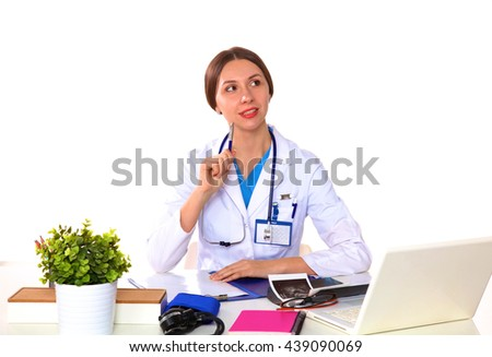 young girl doctor sits at a desk in the Office