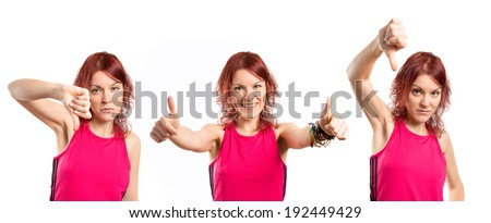 Young girl doing a bad and ok signal. - stock photo