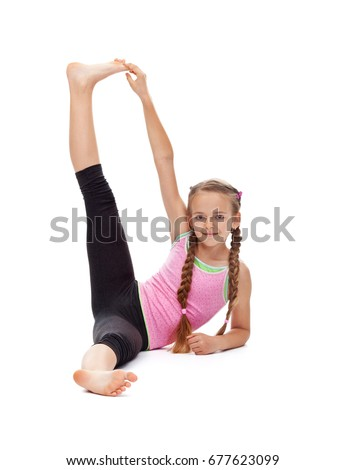 Young girl doing a stretching gymnastic exercise and smile - isolated