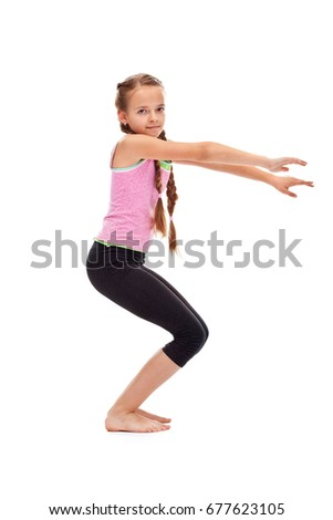Young girl doing gymnastic exercise - side view, isolated