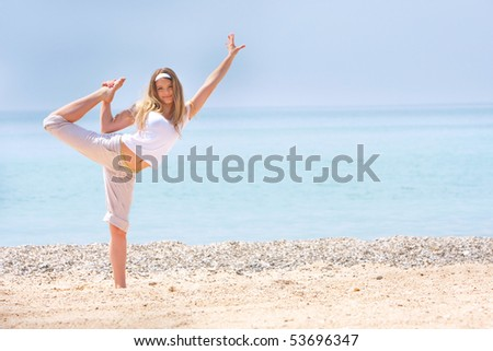 young girl doing gymnastics on beach - stock photo
