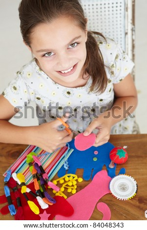 Young girl doing handicrafts