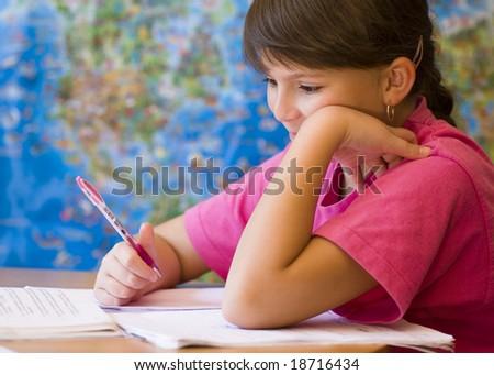 Young girl doing his homework - stock photo