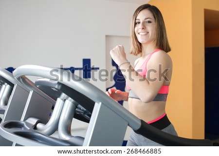 young girl doing legs exercise at gym