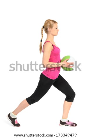 Young girl doing lunges exercise with medicine ball - stock photo