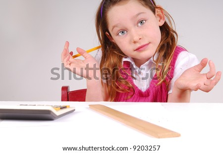 Young Girl Doing Math Looking Confused - stock photo