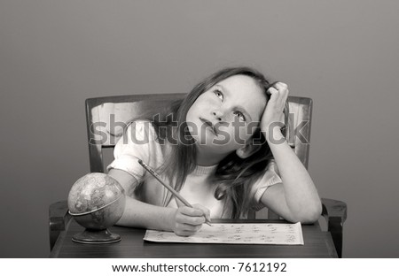 Young Girl Doing Schoolwork Looking Thoughtful or Distracted - stock photo
