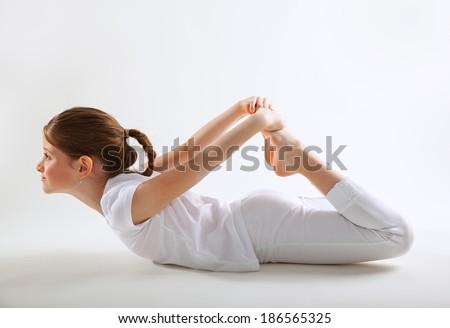 Young girl doing yoga - stock photo