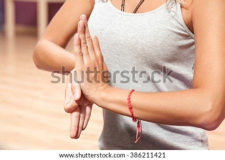 young girl doing yoga special posture indoors closeup on purple mat - stock photo