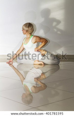 young girl doing yogic exercise. pigeon pose, stretch the legs and thighs.