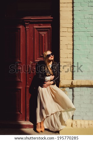 young girl dress in light air posing in the street