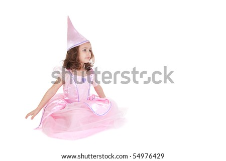 Young girl dressed as fairy princess sitting isolated on white