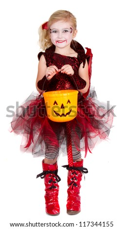 Young girl dressed in Halloween costume as a vampire - stock photo