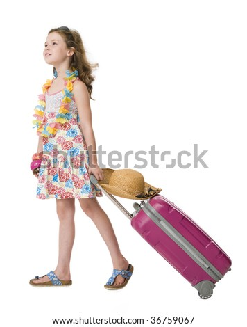 Young girl dressed in holiday clothes pulling suitcase